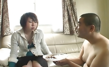 Japanese teenager feeds a naked fat man her chewed up food