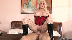 Ravishing cougar in a red corset makes her boy toy break a sweat