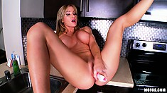 Busty and bootylicious mami fucking herself raw with a big dildo