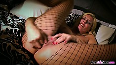 Blonde babe Darryl Hanah plays with her tits and with her slick slit