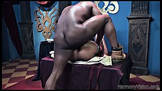 The big black cock deeply invades her tight ass and the ebony beauty fully enjoys it