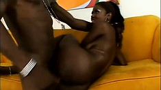 The ebony beauty sighs with pleasure as his big black shaft fills her tight pussy