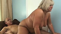 Her huge boobs and big round ass shake and bounce as she rides his throbbing dick