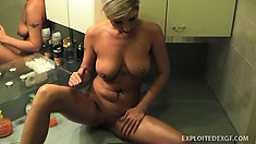 Busty blonde girlfriend gives him a show in the bathroom showing it all