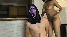 She got a knock at the door and it was a naked masked guy to satisfy