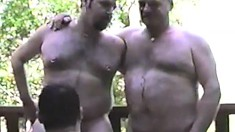 Some chunky gay fuckers are having an orgy of hide the sausage