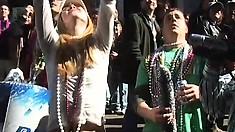 Babes having fun in Mardi Gras flash their tits at the crowd