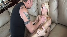 Exciting blonde with perfect boobs enjoys a rough pounding on the sofa