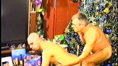 Bald headed stud has a horny older guy drilling his ass from behind