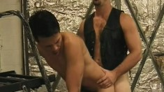 Strong stud in a leather vest enjoys anal with a sexy young man