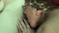 Naughty old ladies fill each other's loose cunts with a strap-on