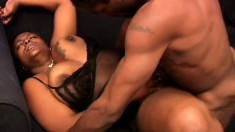 Chunky ebony woman has a muscled black stud fucking her twat on the sofa