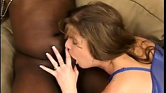 Busty mom takes a black dick in her twat while another fills her mouth